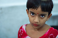 Five-year-old girl who has been raped in a slum outside Dhaka. Because of corruption and ineffectivity the culprit hasn't been punished (photo:  Michael Lund)